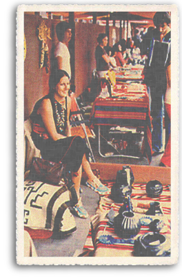 A Native American (Indian) woman sells her authentic, handcrafted wares at the annual world famous Indian Market on the portal of the Palace of the Governors in downtown Santa Fe, New Mexico.
